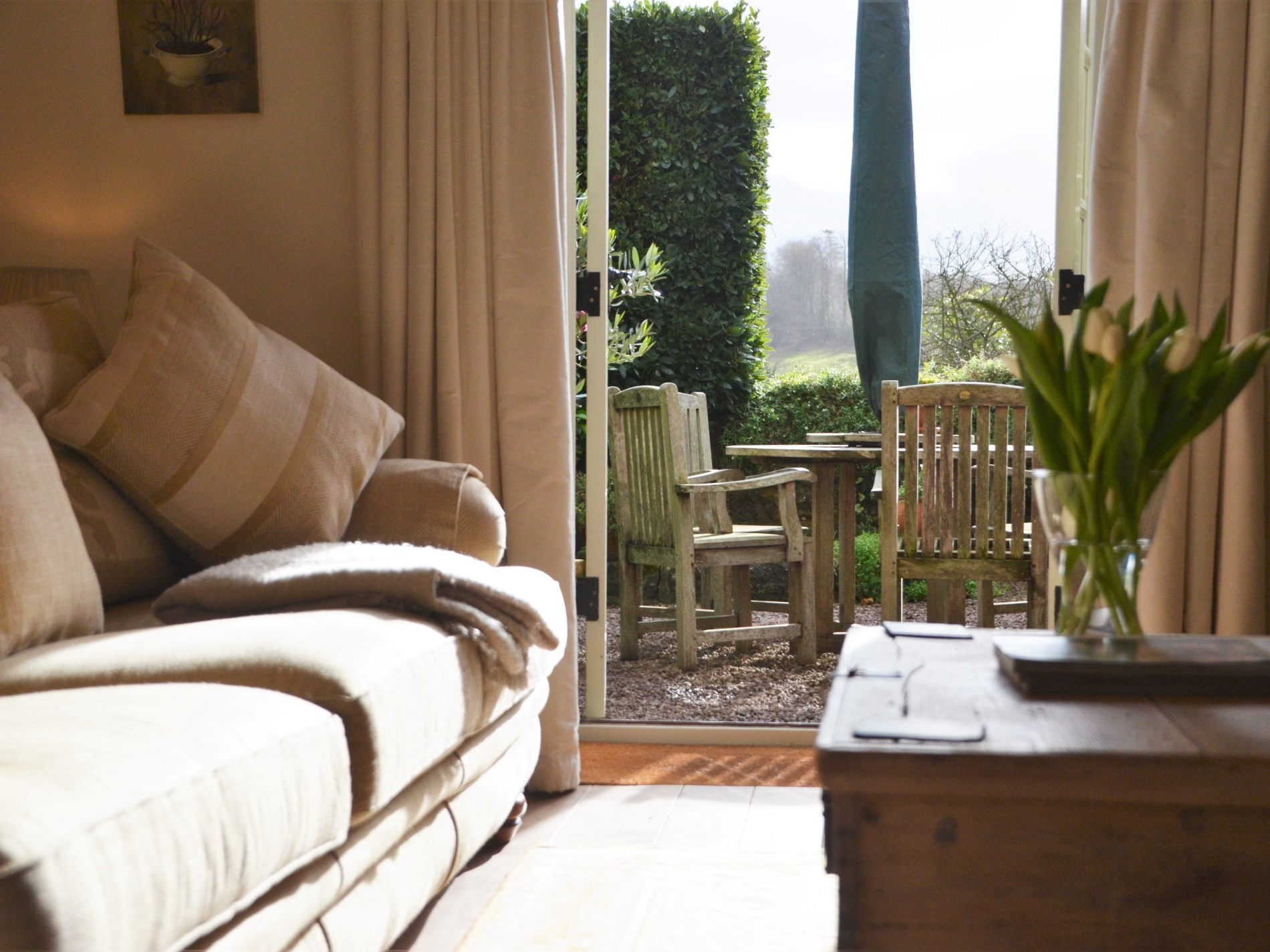 A cosy lounge with access onto the courtyard garden