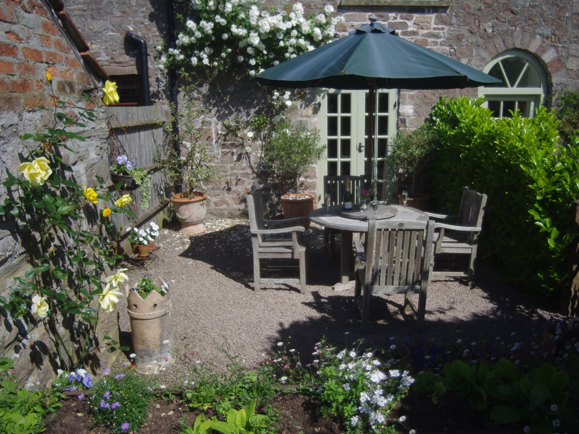 Sit back and relax in the beautiful courtyard garden