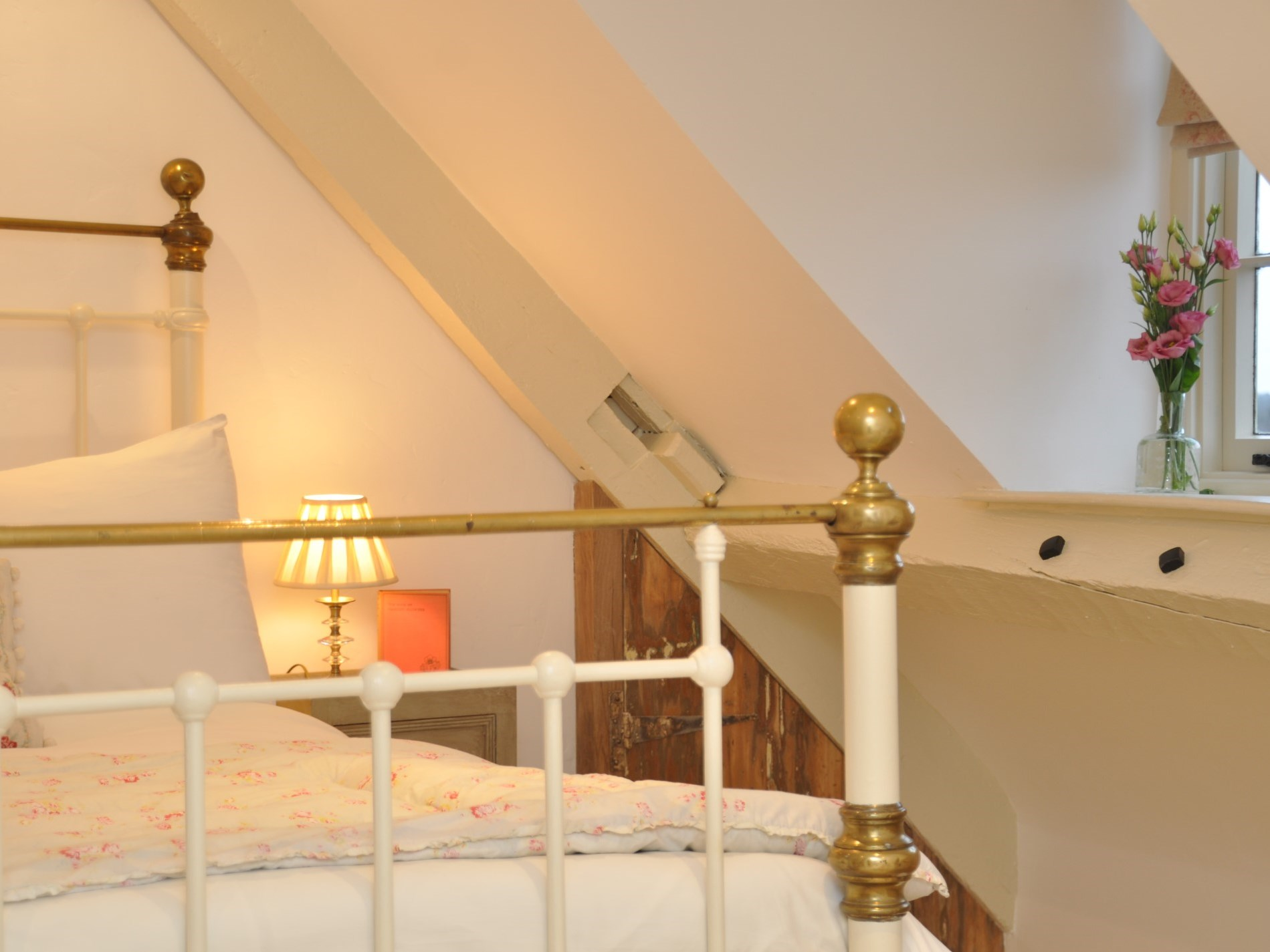 Climb the stairs to a double bedroom with valley views