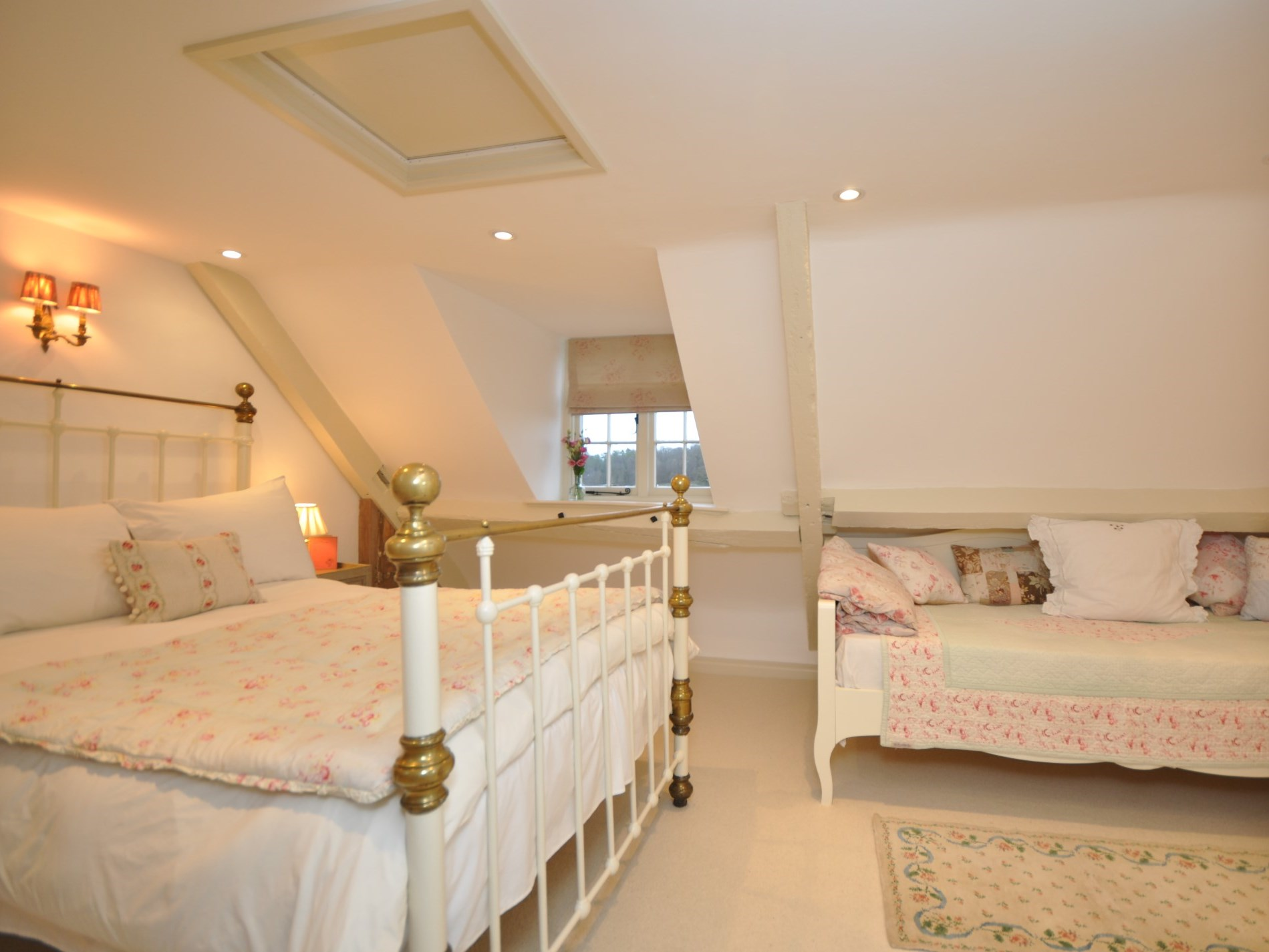 A spacious room with day bed