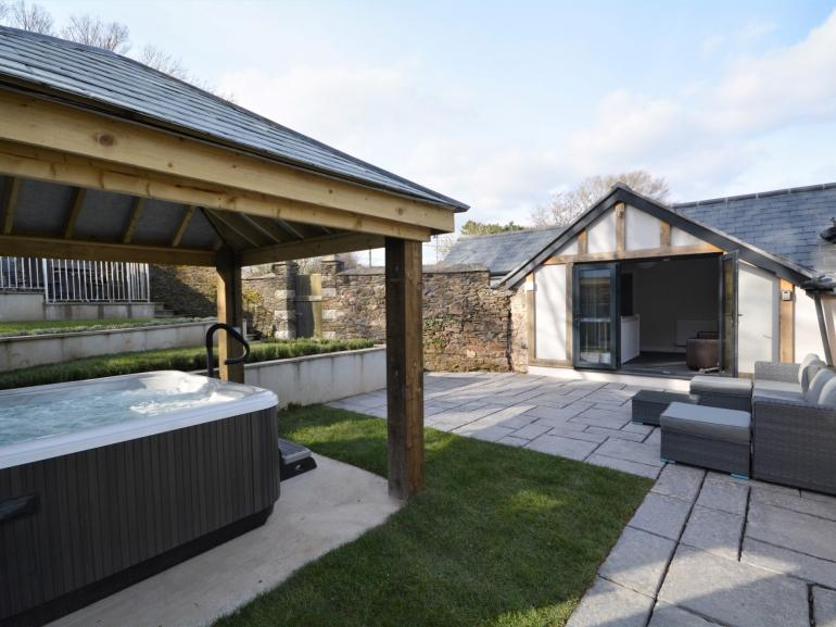 View towards the property,hot tub and enclosed garden