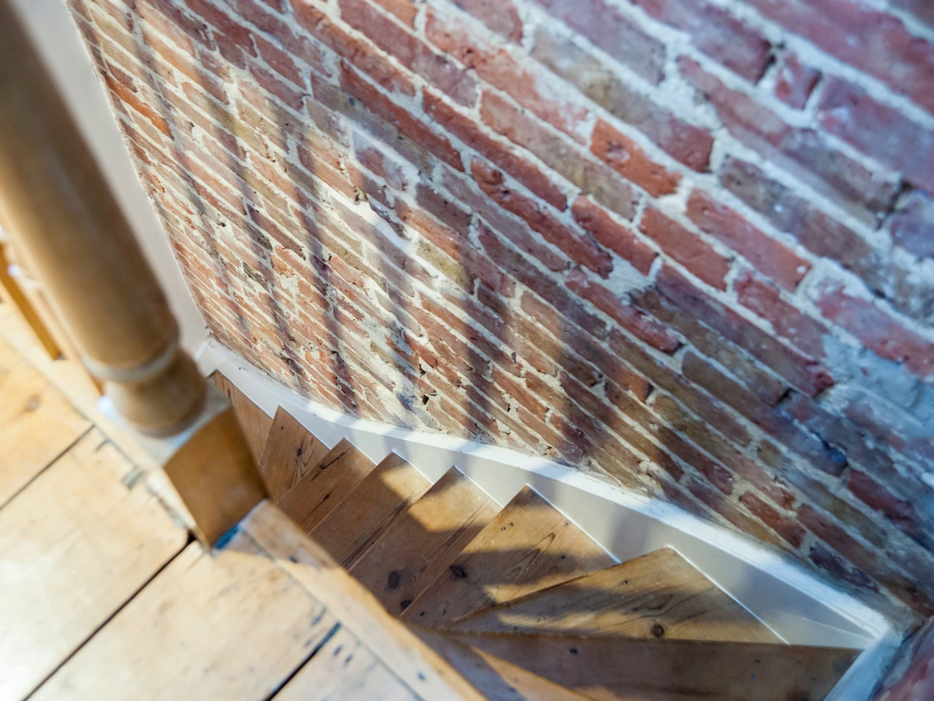Narrow and steep stairs are customary in a property of this age