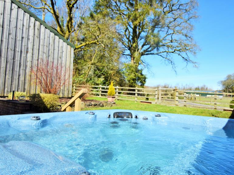 Relax and unwind in your own private hot tub after a busy day exploring