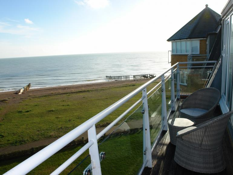Enjoy uninterrupted sea views from the balcony of this elegant apartment