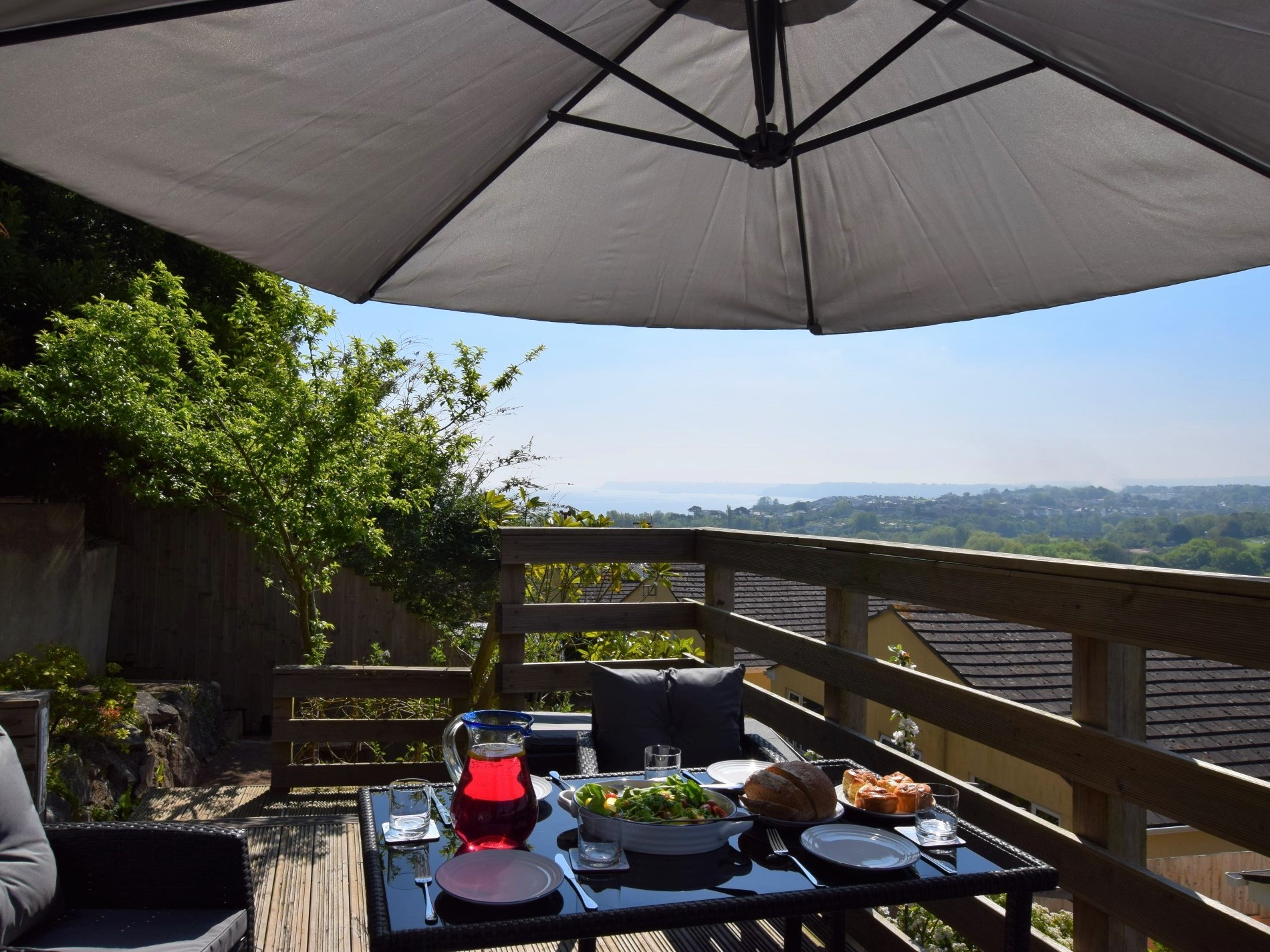Al fresco dining with sea views from the raised decked terrace