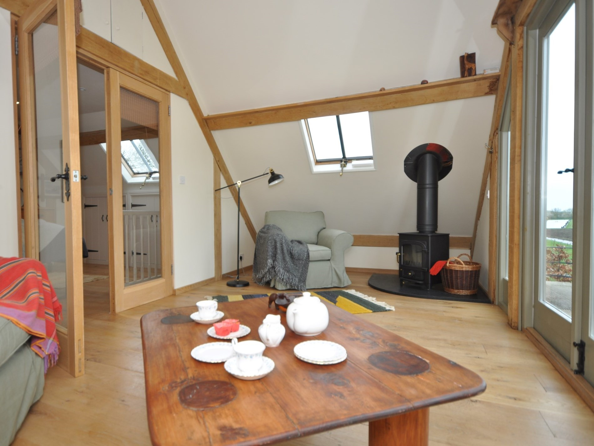 Cosy lounge with wood burner and stunning views