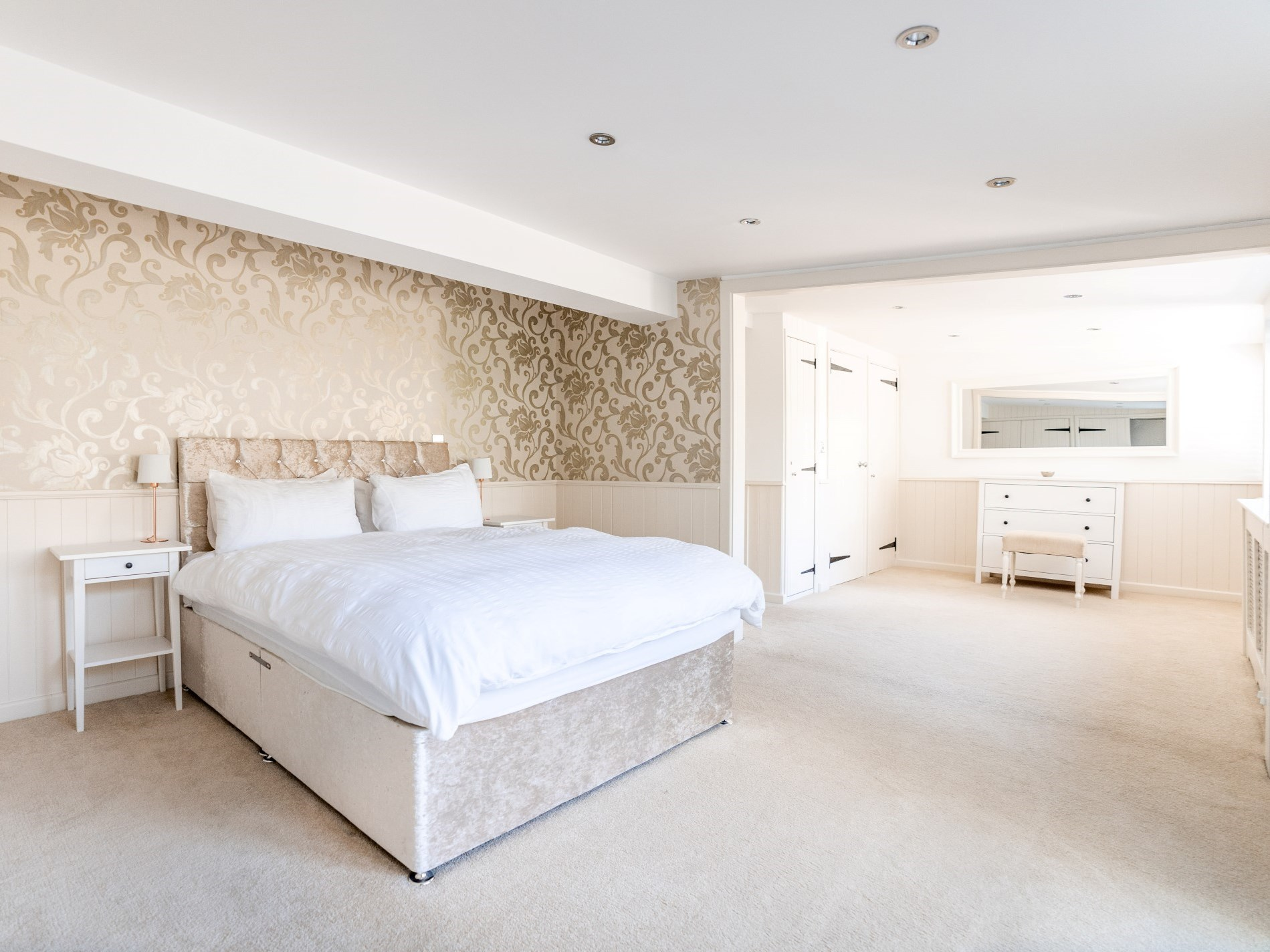 Beautiful king-size bedroom decorated in calming colours