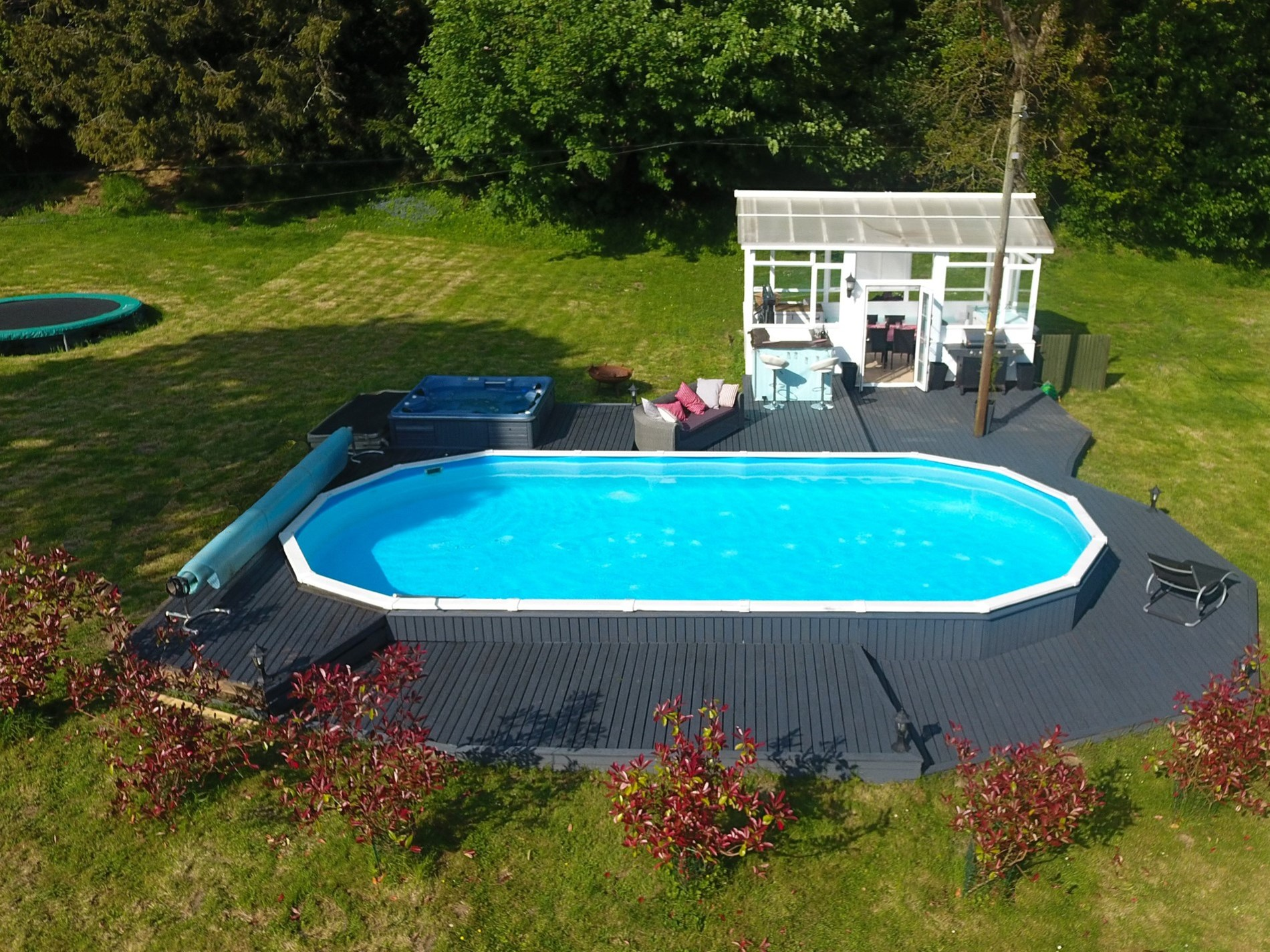 Spend lazy afternoons enjoying the hot tub, pool and summerhouse