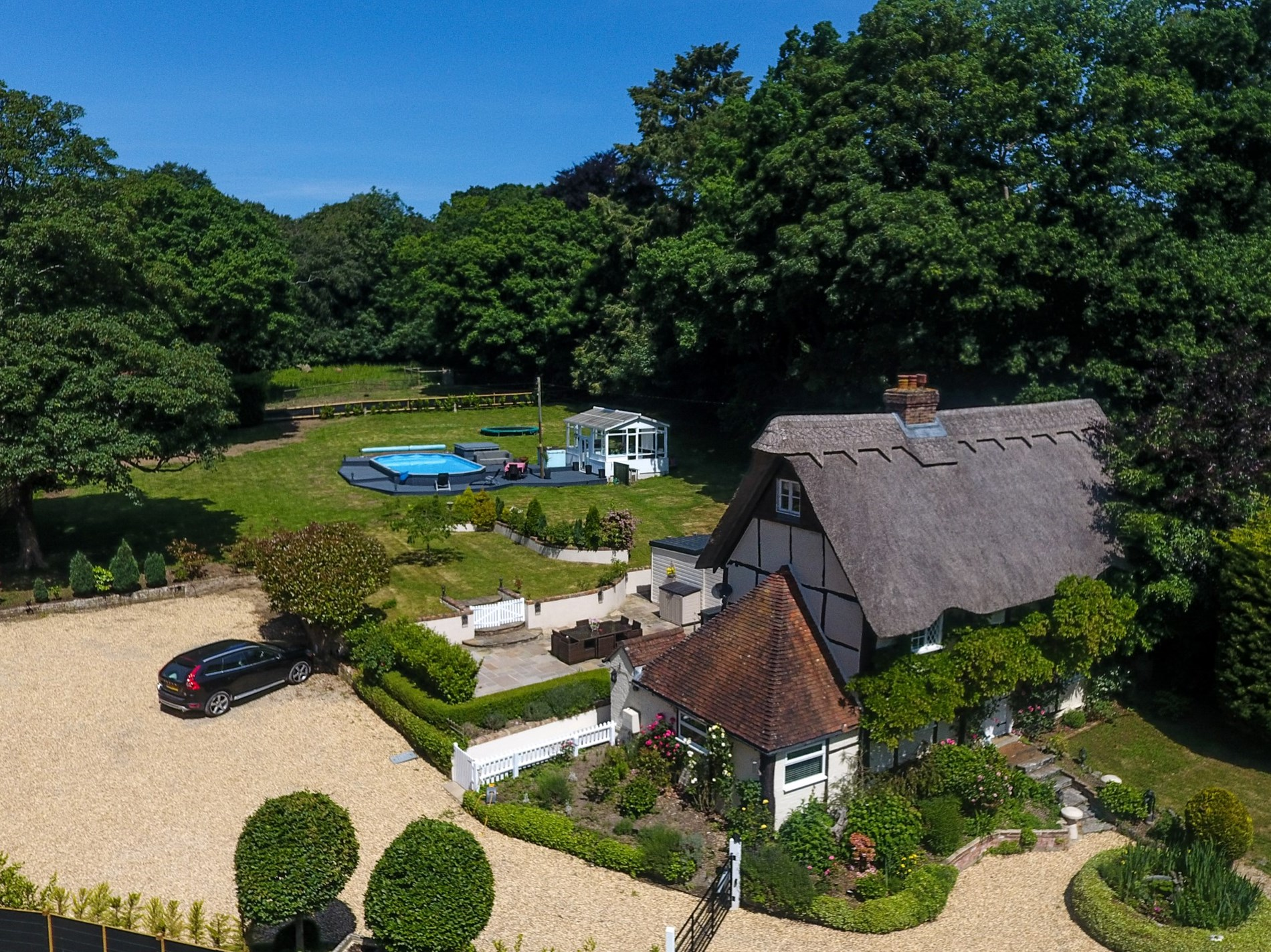 Aerial view of the cottage, pool and grounds