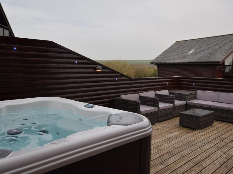 Private decking with hot tub, the perfect spot to unwind