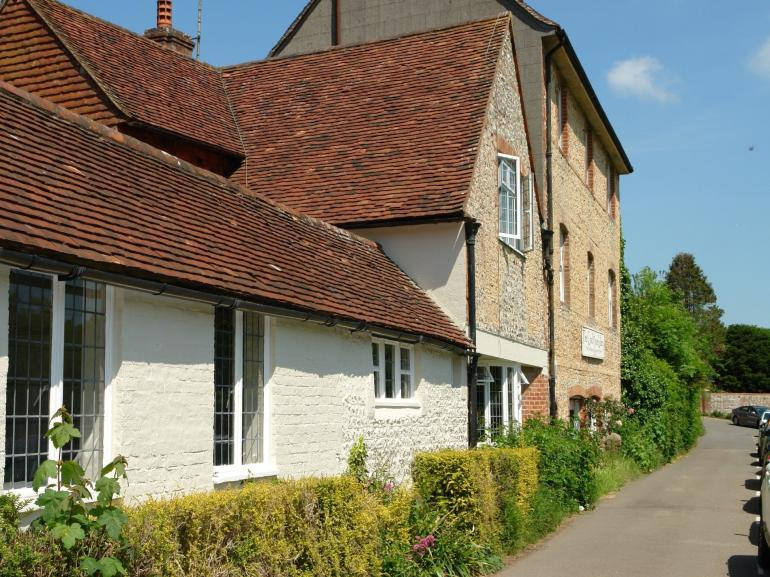 The property is set on a quiet lane overlooking the village green
