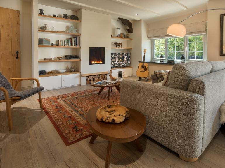 Sit back and relax in front of the contemporary fire