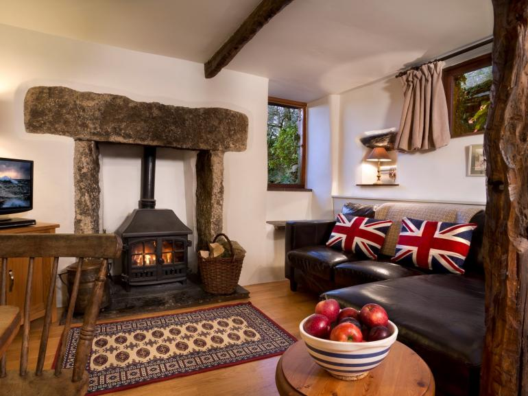 Lounge with stone fireplace and roaring woodburner
