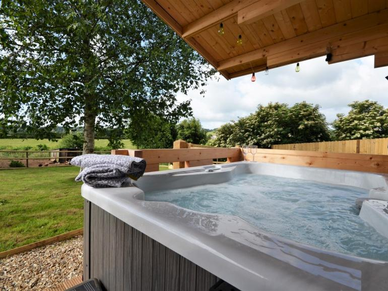 Relax in the hot tub with countryside views