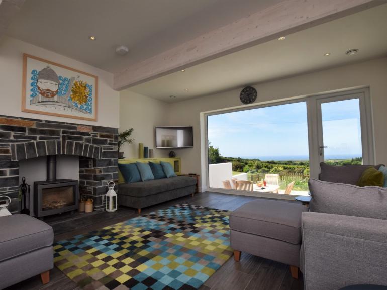 Beautfiul lounge area with distant sea views