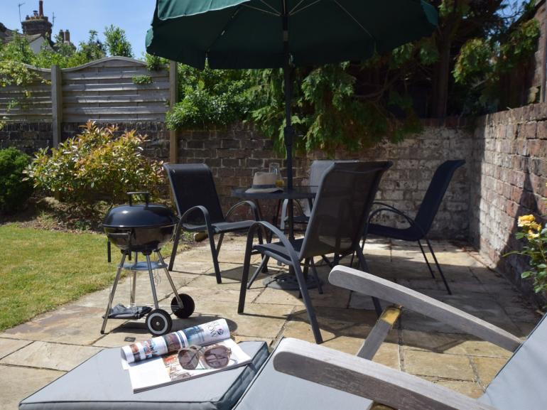 Relax in the sun at the end of the garden