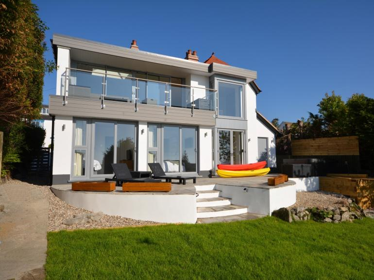 Stunning detached property overlooking the beach with private hot tub