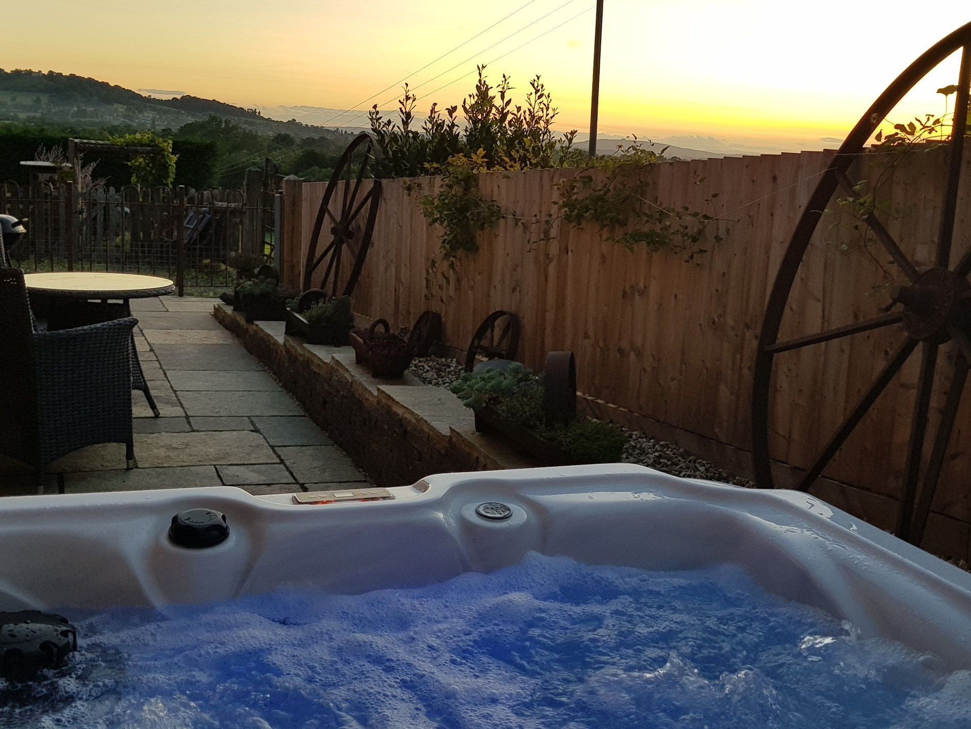 Enjoy the sun setting from your private hot tub