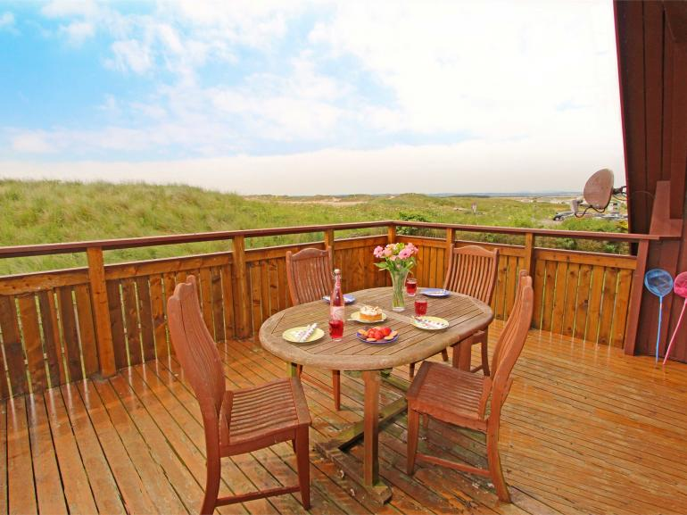 Views from this large private 1st floor decking area toward Beadnell Bay