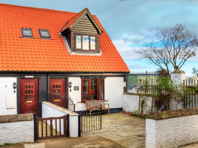 View of the cottage from the front, a great sun trap