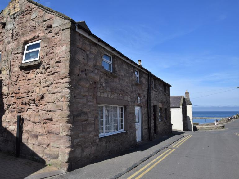 View of the cottage looking down to Seahouses' harbour