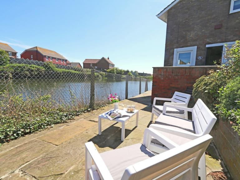 Relax in the garden with views across the lake