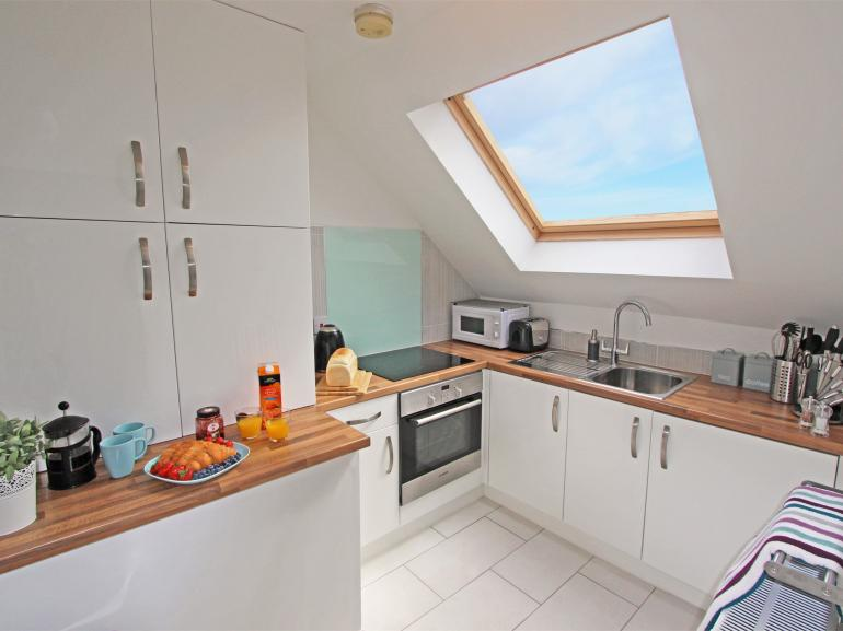 Light and bright kitchen looking out over the sea