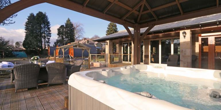 Enjoy time in your own hot tub with lovely garden views