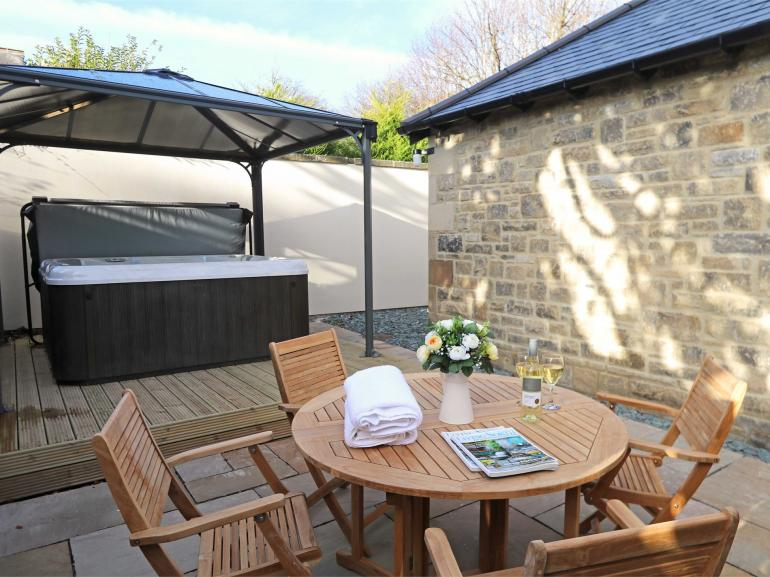 Dine outside or relax in the private hot tub