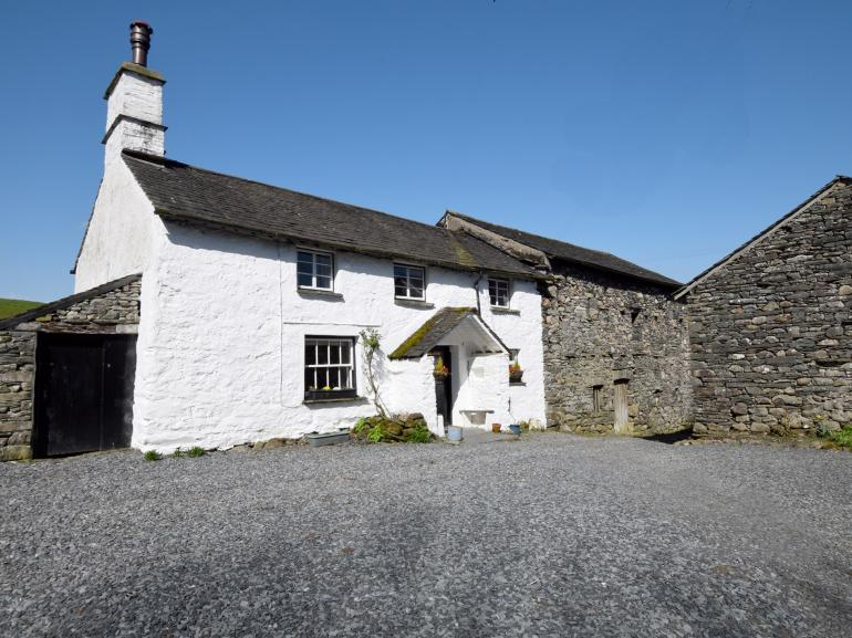 View towards the whitewashed cottage