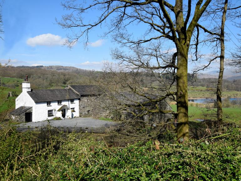 The cottage is surrounded by rolling countryside