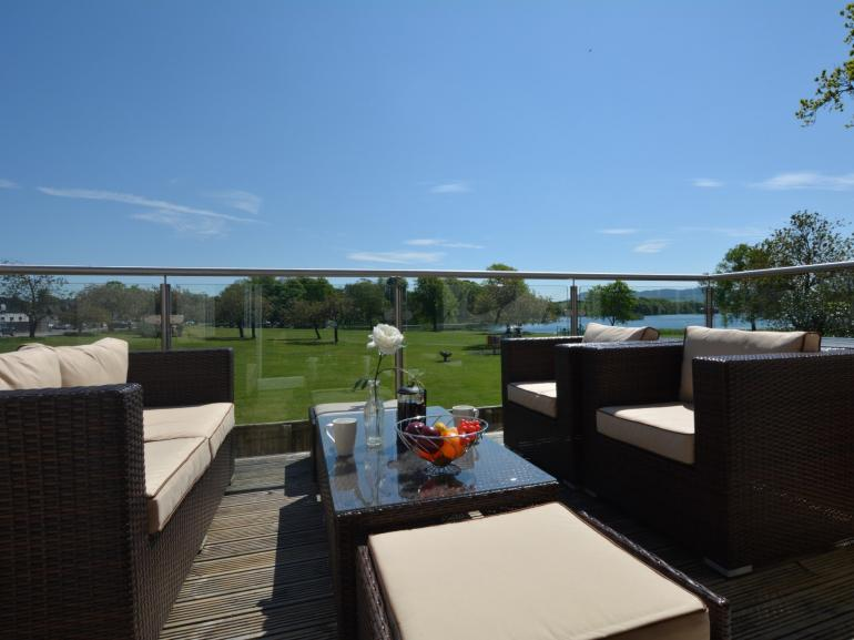 Enjoy al fresco dining on the balcony and admire the stunning views