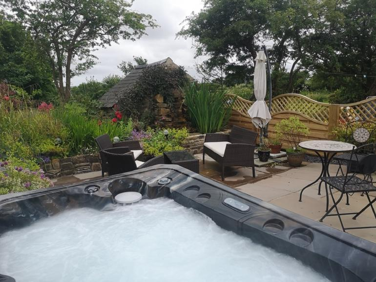 Escape into the hot tub at this fabulous cottage