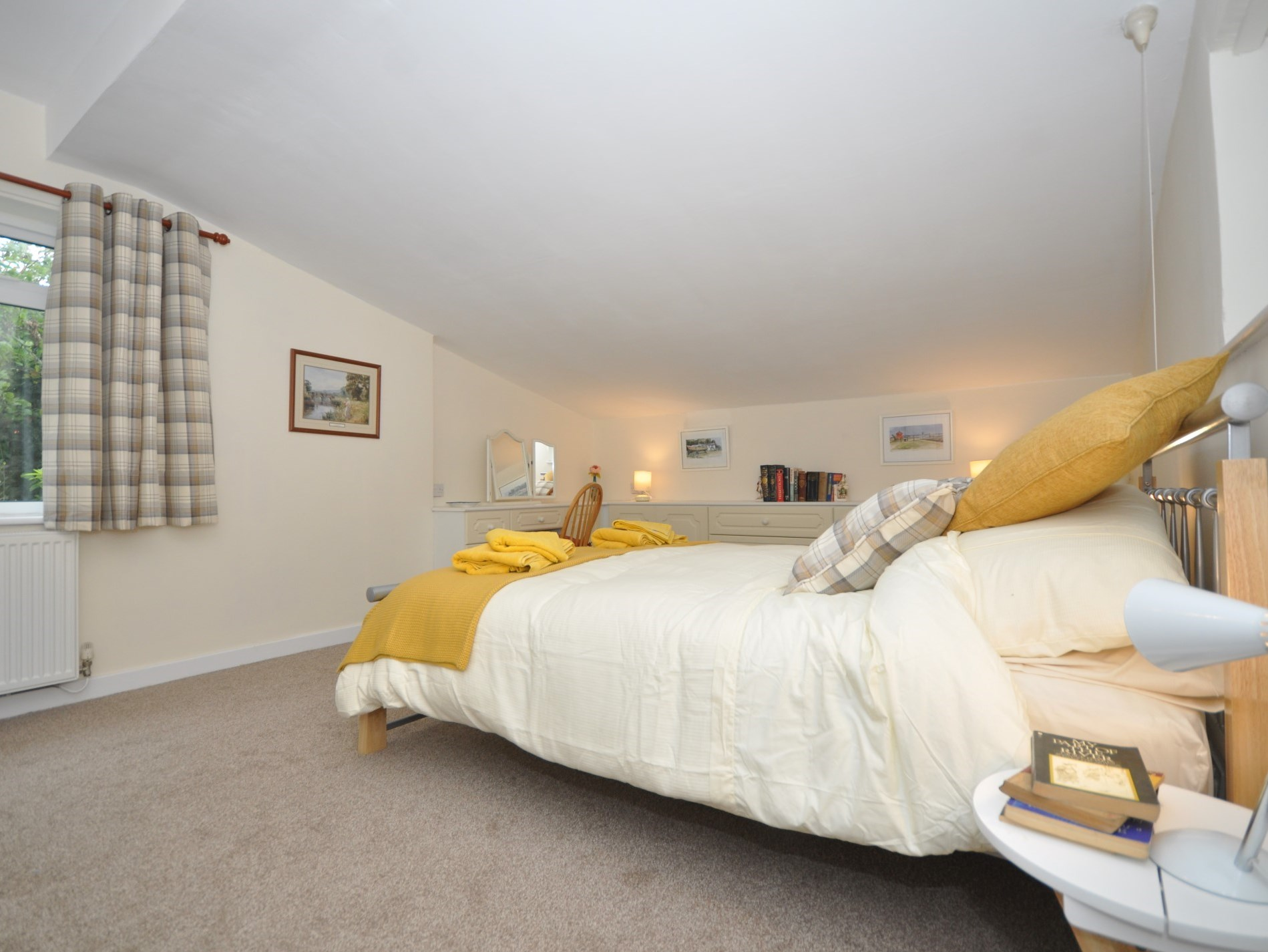 This double bedroom is spacious and suitable for a travel cot