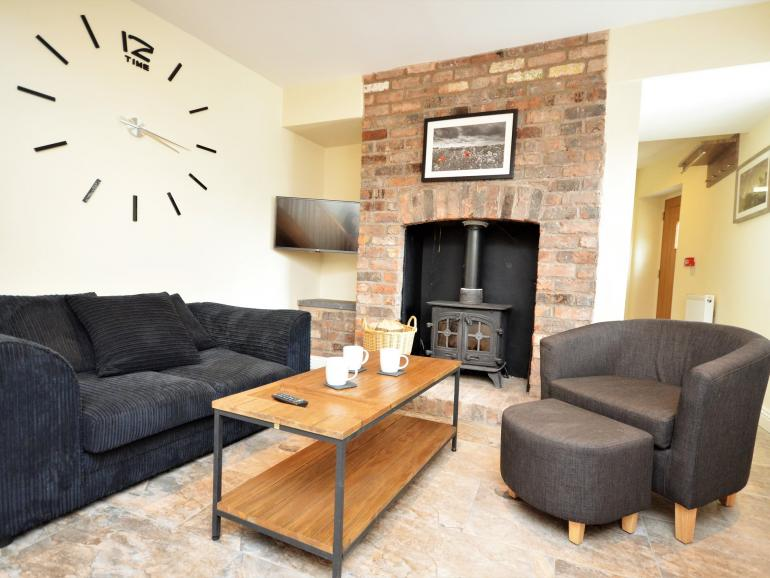 Enter the property and walk through to the cosy lounge with wood burner