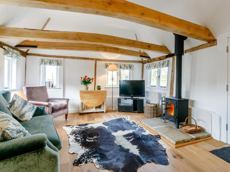 A cosy lounge area with warming wood burner