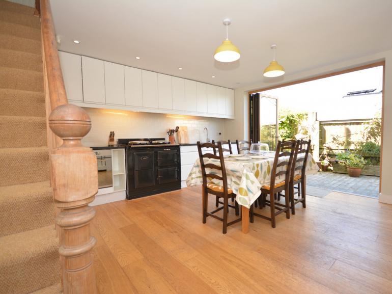 Fantastic kitchen/diner with Aga and bi-fold doors to the rear garden patio