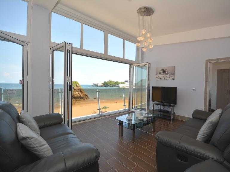 Fabulous beachside apartment with bi-folding doors looking straight out to sea
