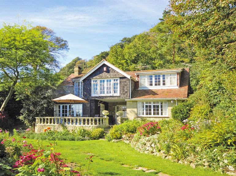 A lovely setting, nestled in mature gardens close to the coastal path