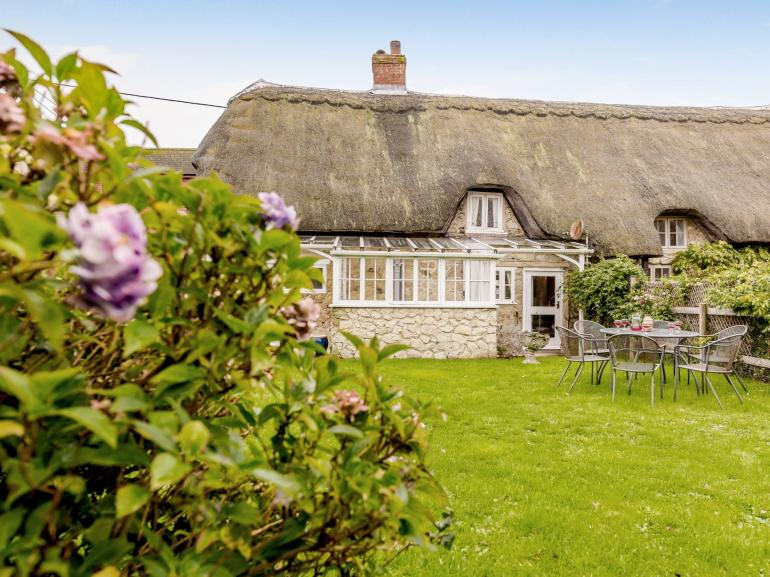 This lovely thatched cottage positioned in the heart of the village