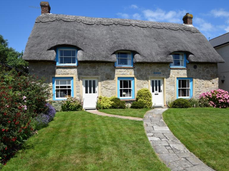 This charming thatched cottage overlooks St Helens' village green