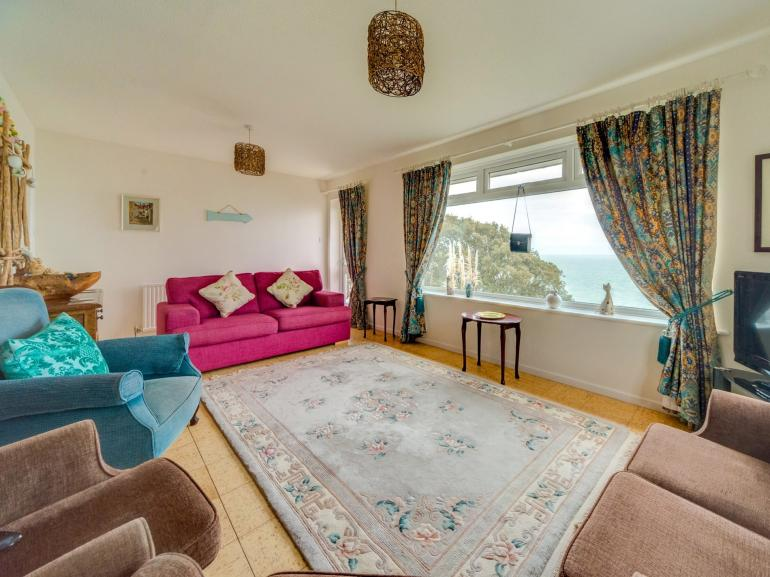 Large family lounge with views straight out to sea