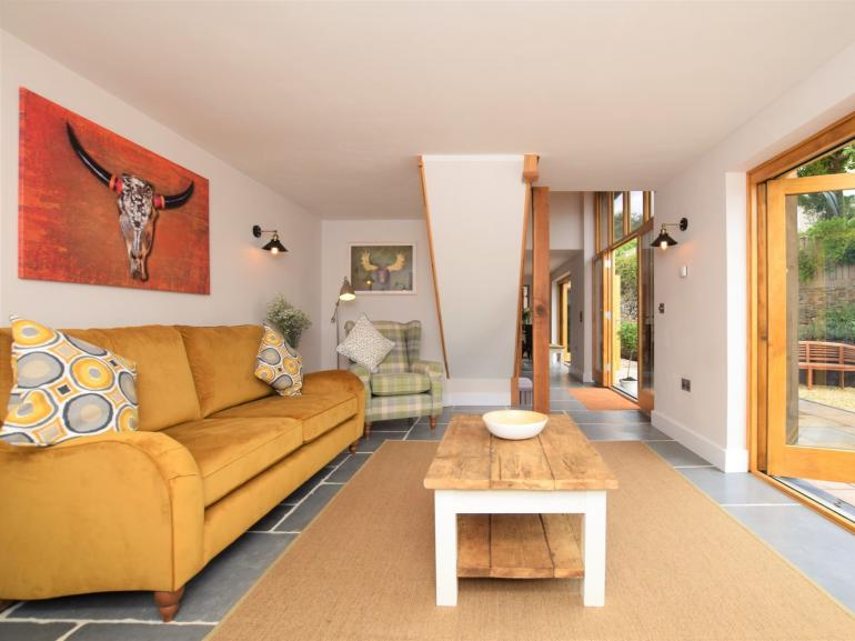 The warm and welcoming lounge with a view of the garden
