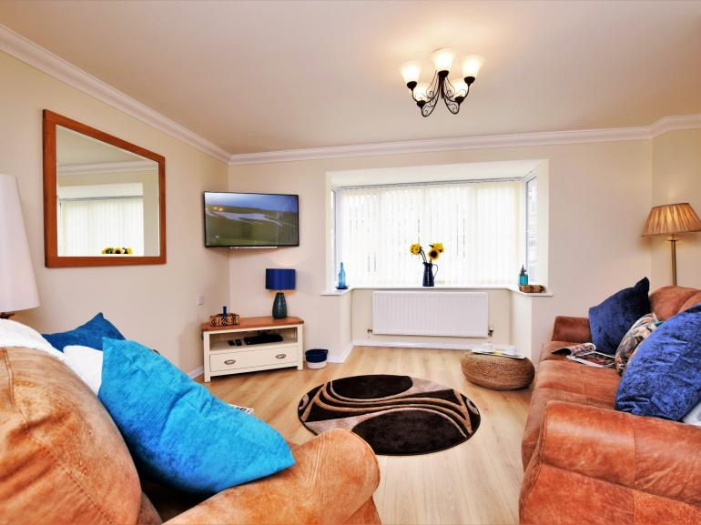 Bright and spacious lounge to relax in after a busy day exploring