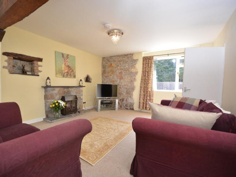 Beautiful double aspect room with wood burner