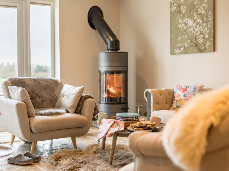 Sit back and unwind by the wood burner