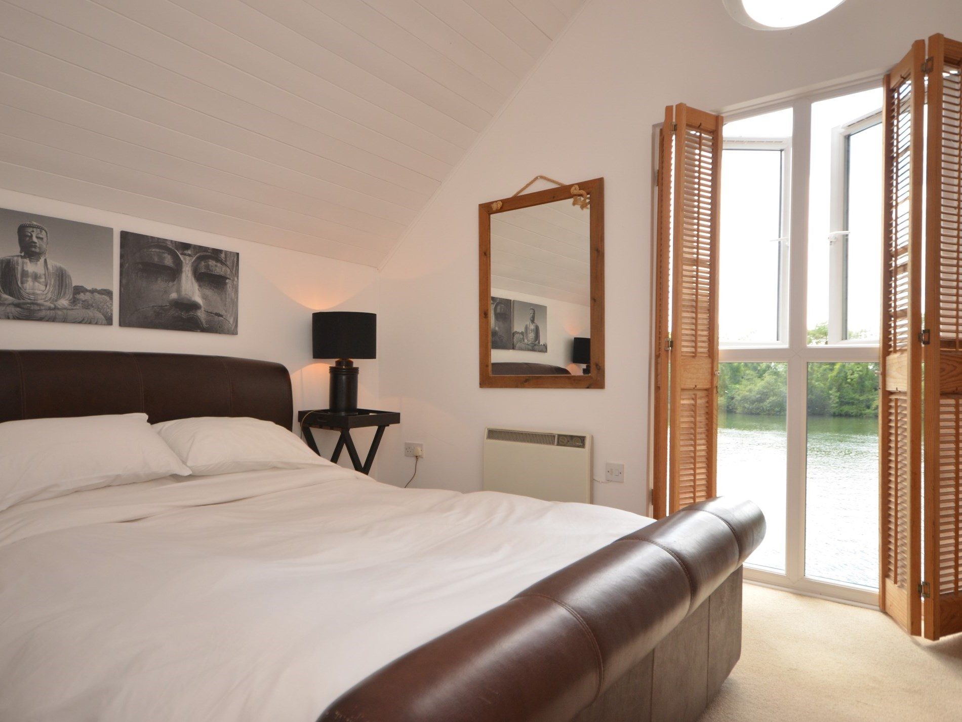 King sized bedroom with wonderful lake views
