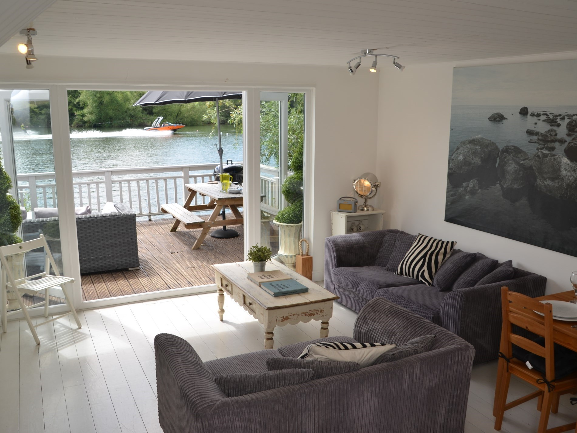 Open plan living area with french windows onto the balcony that overlooks the lake
