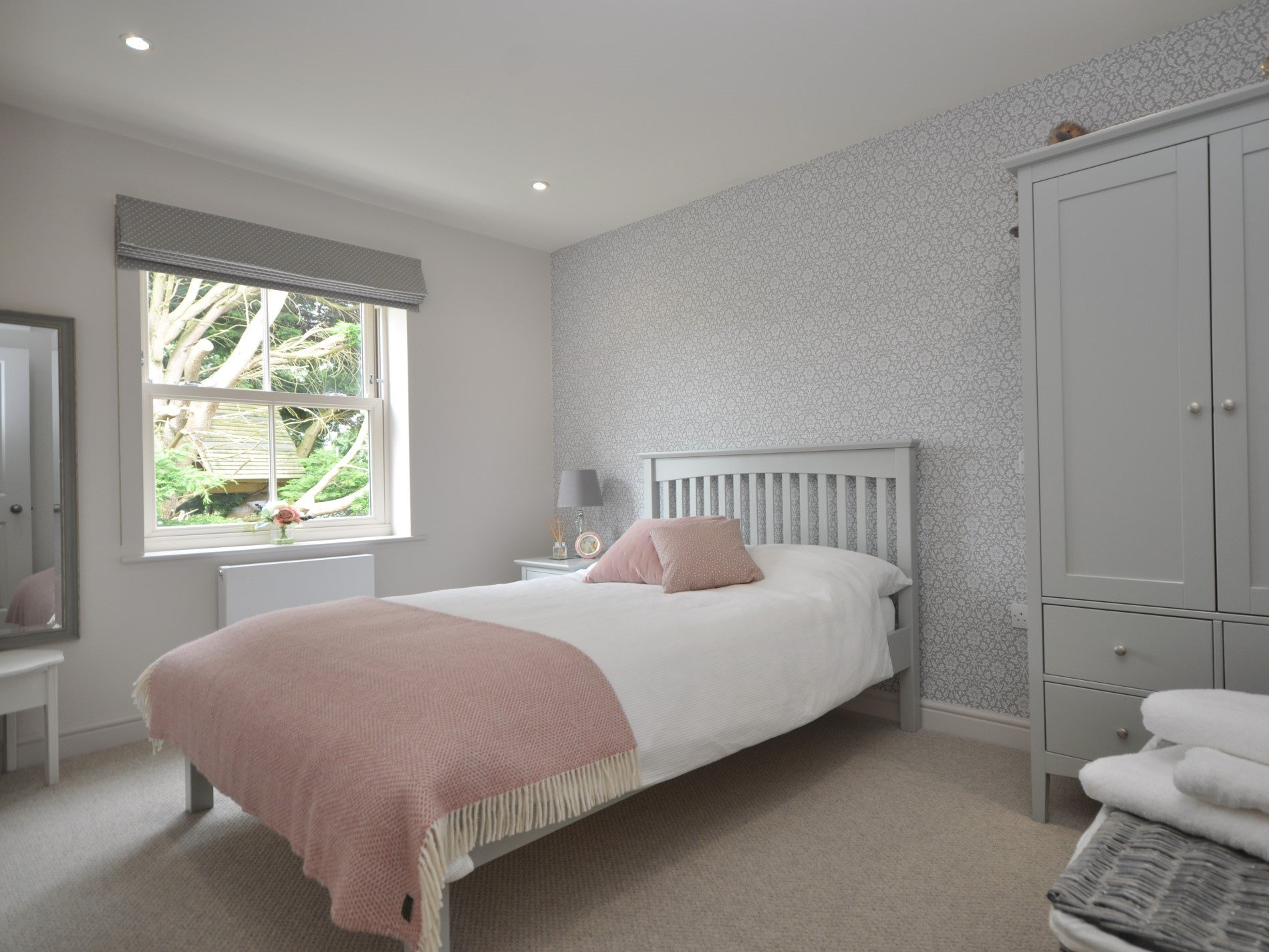 Wake up to bird song and garden views in this first floor double