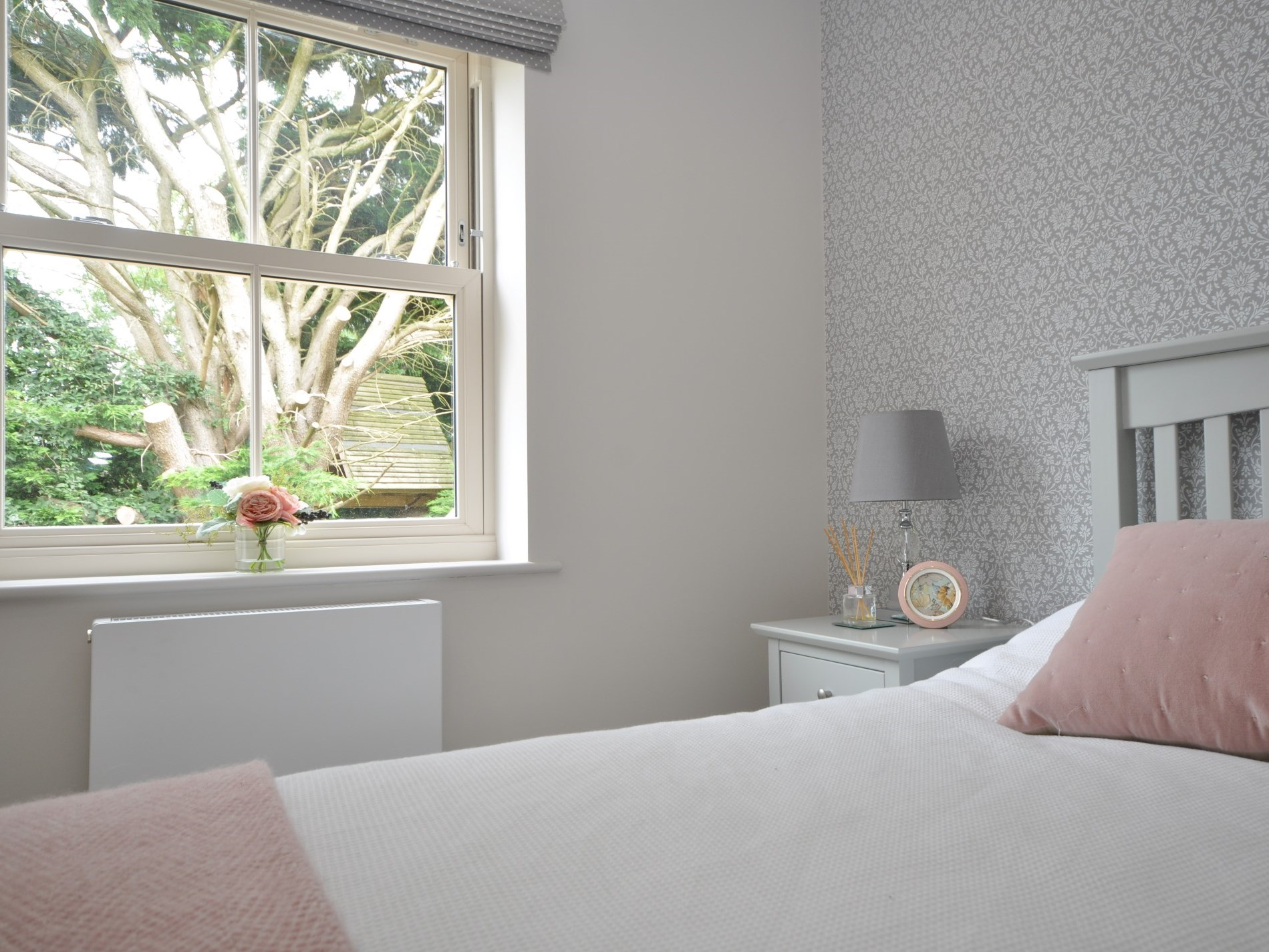 Simple soft furnishings finish the room